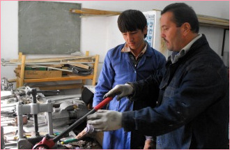 Teacher and student in a vocational school in Tajikistan